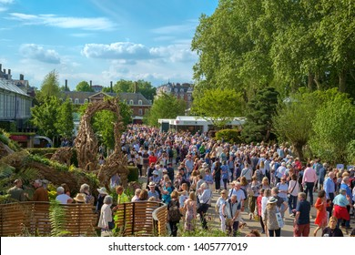 London, UK - May 22nd 2019: RHS Chelsea Flower Show, crowds of visitors make their way towards the gardens and refreshment areas.