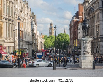 LONDON, UK - MAY 23, 2017: View of Whitehall from Trafalgar Square with Big Ben in the background. Busy street with lots of people and vehicles on a sunny spring day.