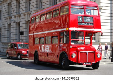 London, UK, May 24, 2009: Famous English Old Double Decker bus and red taxi in street of London
