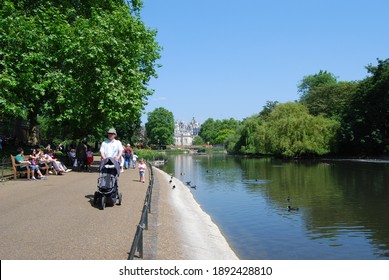 London, UK, May 24, 2009: А man with a baby carriage walks in St. James's Park in London