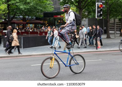 "LONDON, UK - MAY 24, 2018 : A man riding a ""double-decker"" custom made bicycle in the London Bridge area."