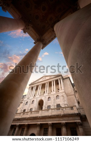LONDON, UK - MAY 24, 2018 : The Bank of England Headquarters in the City of London viewed through columns at sunset