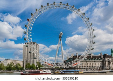 LONDON, UK - MAY 25, 2013: View of the London Eye. London Eye (135 m tall, diameter of 120 m) - a symbol of London and famous tourist attraction over river Thames.