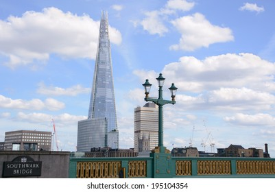LONDON, UK - MAY 25, 2014: The Shard as seen from Southwark Bridge in London on May 25, 2014. The Shard skyscraper is the tallest building in Western Europe and opened in February 2013.