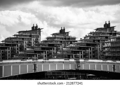LONDON, UK - MAY 25, 2014: Battersea Reach estate behind Wandsworth Bridge in London. Processed in black and white.