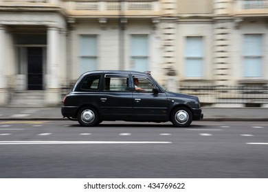 LONDON, UK - MAY 25, 2015: Panning shot of TX4 taxicab manufactured by The London Taxi Company.