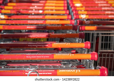 London, UK - May 26, 2019 - Sainsbury's supermarket trolleys stacked in lines