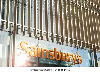 London, UK - May 26, 2019 - Sun glare on Sainsbury's supermarket at Fulham Wharf