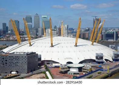 London, UK - May, 26: view of the O2 arena and Canary Wharf in London, UK on May 26, 2015. The O2 arena is a large entertainment complex near Greenwich.