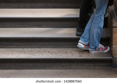 London UK May 26th 2019 : View of colourfull sneakers and blue jeans on stone steps; copy space avaialble on the left