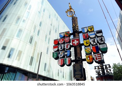 London, UK - May 27, 2016: The Swiss Cantonal Tree on Leicester Square. The tree displays 26 Coats of Arms of Switzerland in London, United Kingdom