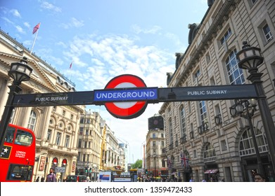 London, UK - May 27, 2016: Sign of underground station in Piccadilly Circus, famous square located at a streets junction of West End in the City of Westminster, London, England