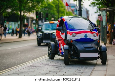 LONDON, UK - MAY 28, 2018:Small modern Renault electric car with union jack flag graphic park in the busy Oxford Street