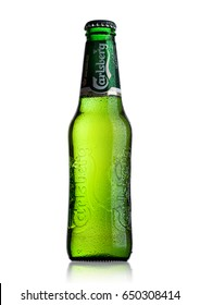 LONDON, UK - MAY 29, 2017: Bottle Of Carlsberg beer on white background. Danish brewing company founded in 1847.