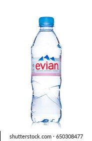LONDON, UK - MAY 29, 2017: Bottle Of Evian Natural Mineral Water on a white background. Made in France. Half liter bottle