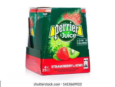 LONDON, UK - MAY 29, 2019: Pack of Perrier and Juice with strawberry and kiwi flavour on white.