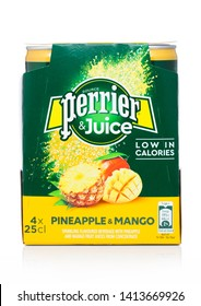 LONDON, UK - MAY 29, 2019: Pack of Perrier and Juice with pineapple and mango flavour on white.