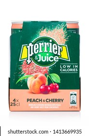 LONDON, UK - MAY 29, 2019: Pack of Perrier and Juice with peach and cherry flavour on white.