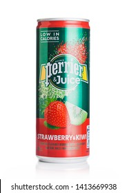 LONDON, UK - MAY 29, 2019: Aluminium can of Perrier and Juice with strawberry and kiwi flavour on white.