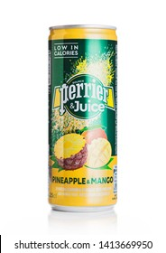 LONDON, UK - MAY 29, 2019: Aluminium can of Perrier and Juice with pineapple and mango flavour on white.