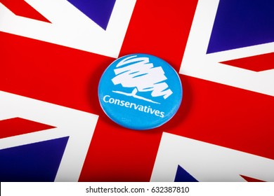 LONDON, UK - MAY 2ND 2017: A Conservative Party pin badge over the UK flag, on 2nd May 2017.