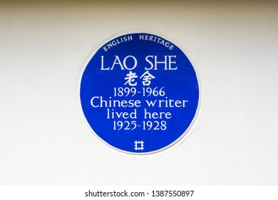 London, UK - May 2nd 2019: A blue plaque marking where famous Chinese novelist and dramatist Lao She lived in West London. He was one of the significant figures of 20th-century Chinese literature.