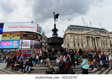 LONDON, UK - MAY 30, 2015: People visit the landmark Piccadilly Circus in Central London. The British capital is one of the world's most visited cities With 17 million international visitors in 2013.