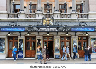 LONDON, UK - MAY 30, 2015: People walk past Her Majesty's Theatre in the West End. The long running Phantom of the Opera had its world premiere at the theatre in 1986, which itself opened in 1705.