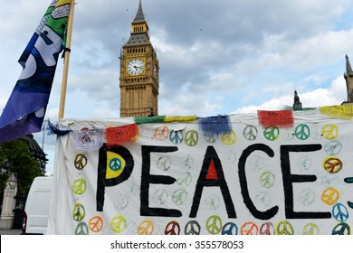 LONDON, UK - MAY 30, 2015: View of a anti-war peace protest banner outside Big Ben and the Houses of Parliament in Westminster.