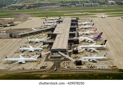LONDON, UK - MAY 30, 2016: Aerial view of planes at Terminal 2 of London Heathrow Airport on a cloudy day. Airlines using this terminal include Air Canada, Singapore Airlines and United Airlines.