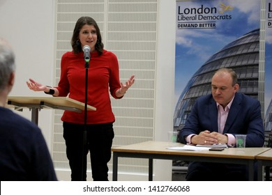 London / UK – May 31, 2019: Jo Swinson, Liberal Democrat MP for East Dunbartonshire, speaking at the party's leadership election hustings in London, with rival candidate Ed Davey sitting down.