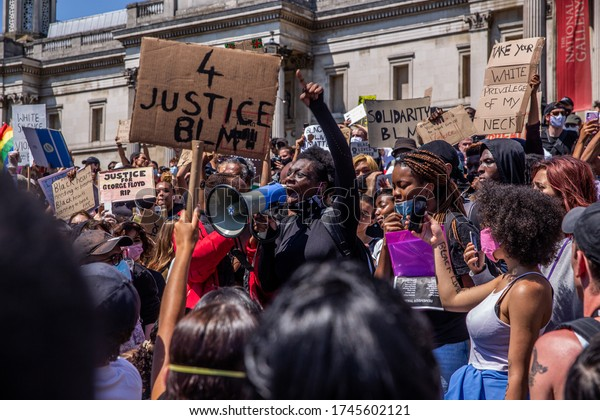 London / UK - May 31 2020: Black Lives Matter protesters march from Trafalgar Square to US Embassy for George Floyd