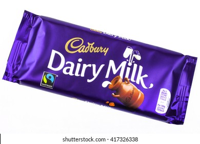 LONDON, UK - MAY 6TH 2016: An unopened Dairy Milk chocolate bar manufactured by Cadbury, pictured over a plain white background on 6th May 2016.