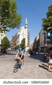 LONDON, UK - MAY 7, 2018: A cyclist riding through Seven Dials in Covent Garden on a sunny day.