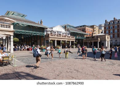 LONDON, UK - MAY 7, 2018: Outside view, with people, of the famous covered markets in Covent Garden.