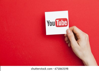 LONDON, UK - May 7th 2017: Hand holding YouTube logo. Youtube is a popular video sharing service founded in 2005