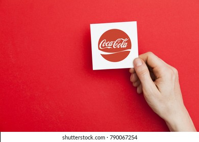 LONDON, UK - May 7th 2017: Hand holding coca cola logo. coca cola is a global soft drinks company