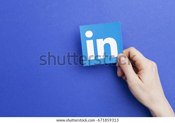 LONDON, UK - May 7th 2017: Hand holding LInkedin logo. Linkedin is a popular business networking website
