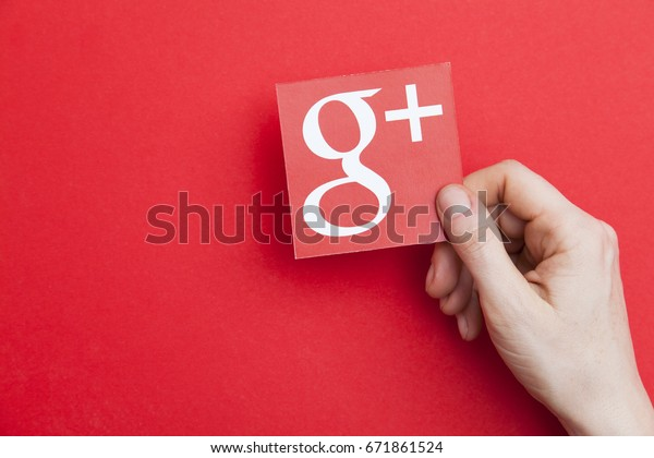 LONDON, UK - May 7th 2017: Hand holding Google plus logo. Google plus is an internet based social network operated by Google