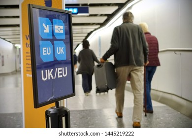 London, UK - May 9, 2019: Air travelers proceed along the UK/EU arrivals lane to passport control at Heathrow airport. The immigration status of EU citizens remains unclear after Brexit day.