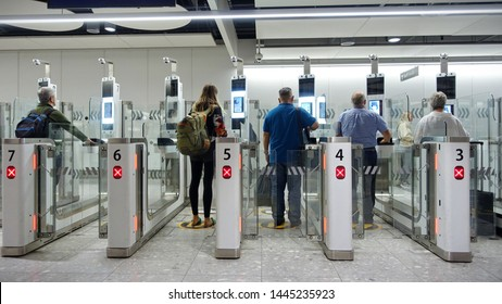 London, UK - May 9, 2019: Air travellers pass through automated passport border control gates at Heathrow Airport. The UK Border Force is on a recruitment drive in gearing up for Brexit.