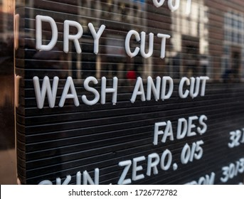 London, UK. May 9th 2020: A barber shop shop price board. Hairdressing and styling. Coronavirus, lockdown, stay at home, social distancing, back to work, small business, economy, finance, re-open.