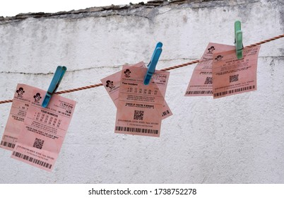 London UK : UK National lottery and thunder ball tickets are clipped on washing line.