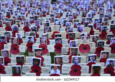 LONDON, UK - NOV 10: Poppies at the Westminster Abbey Garden of Remembrance, on Nov 10, 2013 in London UK. Members of the armed forces who lost their lives in Afghanistan a photo adds to the poignancy