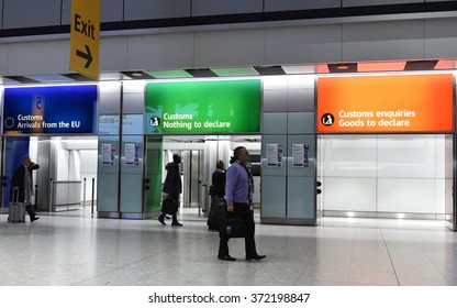 LONDON, UK - NOV 18, 2015: Air travellers pass through customs channels at Heathrow Airport. The UK's main aviation hub is the busiest airport in Europe by passenger traffic.