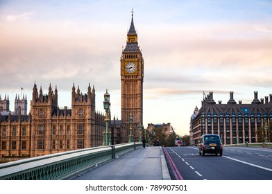 LONDON, UK - NOVEMBER 03, 2012:  Black Taxicab moves along the Westminster Bridge with Elizabeth Tower or Big Ben in background