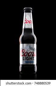 LONDON, UK - NOVEMBER 03, 2017: Bottle of Coors Light beer on black background. Coors operates a brewery in Golden, Colorado, that is the largest single brewery facility in the world.