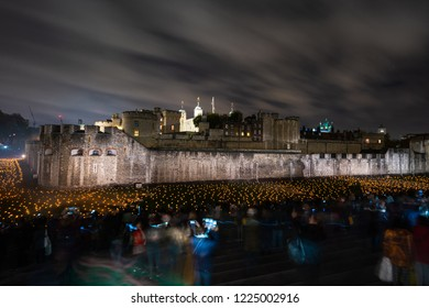 LONDON, UK - NOVEMBER 06, 2018: The Tower of London's moat has been filled with around 10,000 lit torches to mark the centenary of the end of the First World War.