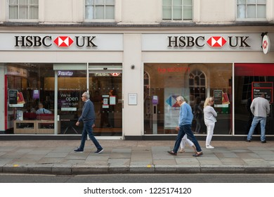 London, UK - November 07, 2017: HSBC bank branch on King's Road, Chelsea. Man withdrawing cash from ATM machine. People passing by. HSBC bank is the 7th largest bank in the world.