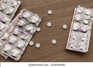 London / UK - November 1 2018: modafinil (modalert by Sun Pharma) pills and blister packet. A eugeroic drug used to treat narcolepsy, sleep shift disorder and as a cognitive enhancer for study